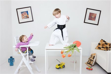 Boy on Table in Karate Pose Stock Photo - Rights-Managed, Code: 700-02724696