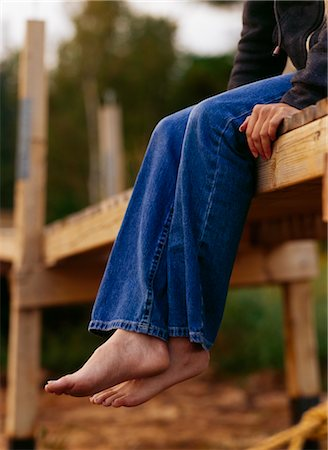 Girl Sitting on the Edge of a Wooden Dock at Sunset Stock Photo - Rights-Managed, Code: 700-02723074