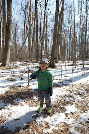 Boy Standing in Forest Stock Photo - Rights-Managed, Code: 700-02738114