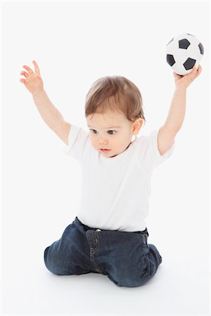 Little Boy Playing With Soccer Ball Stock Photo - Rights-Managed, Code: 700-02738147