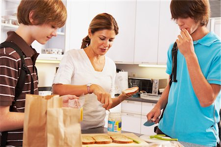 Mother Making School Lunches for Sons Stock Photo - Rights-Managed, Code: 700-02738795