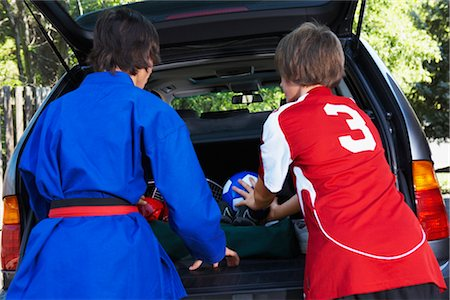 Boys in Karate and Soccer Uniforms Packing the Car Stock Photo - Rights-Managed, Code: 700-02738847