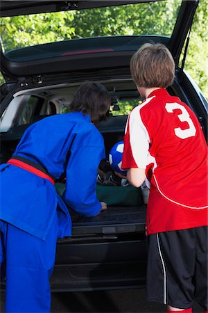 Boys in Karate and Soccer Uniforms Packing the Car Stock Photo - Rights-Managed, Code: 700-02738848