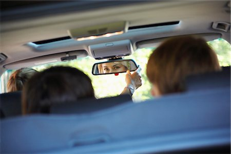 Mom Looking in Rear-View Mirror Stock Photo - Rights-Managed, Code: 700-02738856
