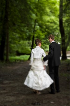 Bride and Groom Walking in Woods, Chamonix, Haute-Savoie, France Stock Photo - Rights-Managed, Code: 700-02749434