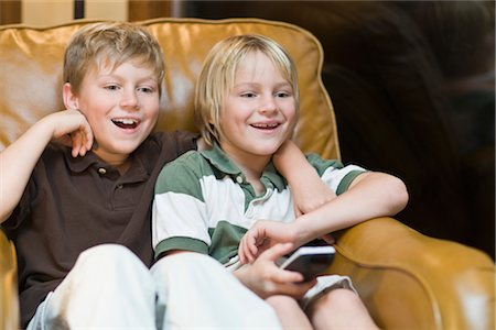 Two Boys Watching TV Stock Photo - Rights-Managed, Code: 700-02757123