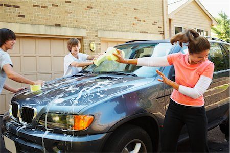 Woman with Teenage Sons Washing Car Stock Photo - Rights-Managed, Code: 700-02757199