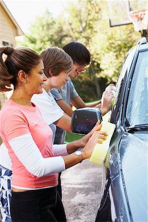 Mother and Teenage Sons Washing Car Stock Photo - Rights-Managed, Code: 700-02757205
