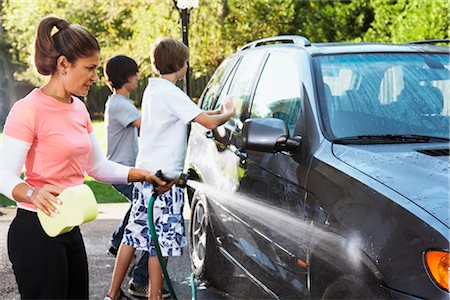 Woman and Teenage Sons Washing Car Stock Photo - Rights-Managed, Code: 700-02757207