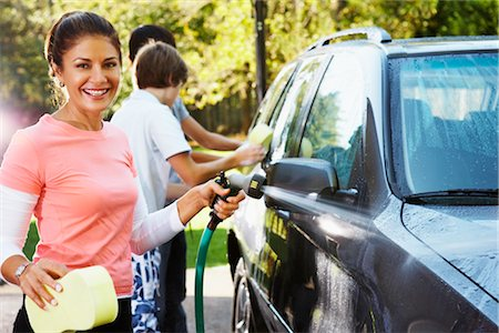 Woman and Teenage Sons Washing Car Stock Photo - Rights-Managed, Code: 700-02757209
