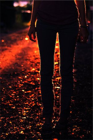 Silhouette of Woman Standing Outdoors at Dusk Stock Photo - Rights-Managed, Code: 700-02786842