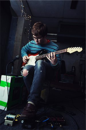 Young Man Playing Guitar Stock Photo - Rights-Managed, Code: 700-02786867