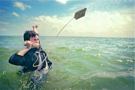 phone cord - Businessman in the Ocean Talking on Telephone Stock Photo - Rights-Managed, Code: 700-02786874
