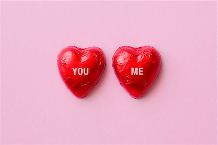 You and Me Written on Foil Wrapped Chocolate Hearts Stock Photo - Rights-Managed, Code: 700-02801159