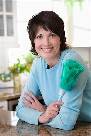 Woman Holding Feather Duster Stock Photo - Rights-Managed, Code: 700-02833575