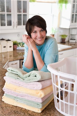 Woman Folding Laundry Stock Photo - Rights-Managed, Code: 700-02833572