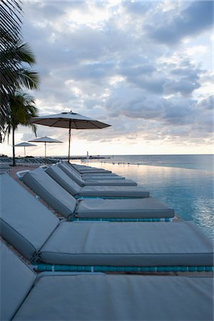Lounge Chairs by Infinity Pool, Grand Bahama Island, Bahamas Stock Photo - Rights-Managed, Code: 700-02887315