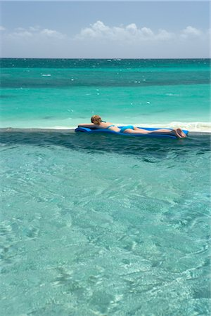 Woman Floating in Pool, Grand Bahama Island, Bahamas Stock Photo - Rights-Managed, Code: 700-02887334