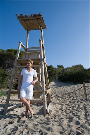 Man by Lifeguard Chair, Ibiza, Spain Stock Photo - Rights-Managed, Code: 700-02887484
