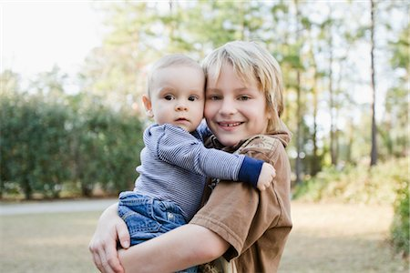 Boy Holding Baby Brother Stock Photo - Rights-Managed, Code: 700-02883113