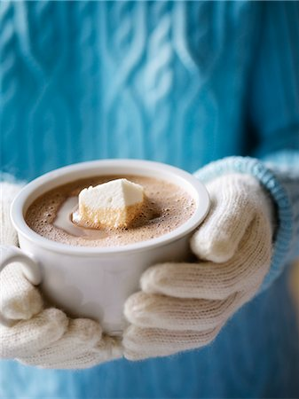 Woman Wearing a Sweater and Mittens Holding a Mug of Hot Chocolate With a Homemade Marshmallow Stock Photo - Rights-Managed, Code: 700-02883260