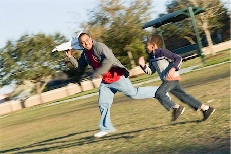 Father and Son Playing With Toy Shuttle in the Park Stock Photo - Rights-Managed, Code: 700-02912039