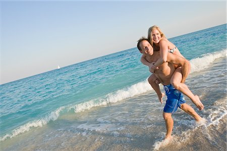 Couple Playing on the Beach Stock Photo - Rights-Managed, Code: 700-02912054