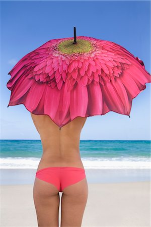 Woman on the Beach Holding an Umbrella Stock Photo - Rights-Managed, Code: 700-02913016