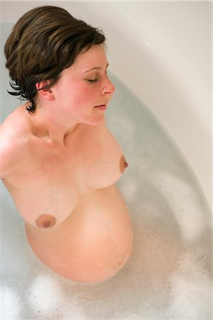 pregnant woman breast - Pregnant Woman Relaxing in the Bathtub Stock Photo - Rights-Managed, Code: 700-02922727