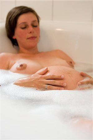 pregnant breast - Pregnant Woman Relaxing in the Bathtub Stock Photo - Rights-Managed, Code: 700-02922730