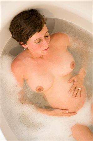 pregnant woman breast - Pregnant Woman Relaxing in the Bathtub Stock Photo - Rights-Managed, Code: 700-02922731