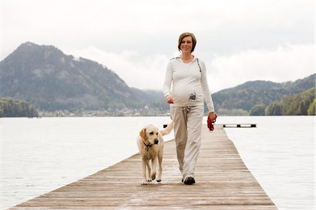 Pregnant Woman Walking on Dock With Her Dog Stock Photo - Rights-Managed, Code: 700-02922754