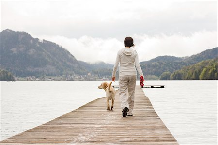Pregnant Woman Walking on Dock With Her Dog Stock Photo - Rights-Managed, Code: 700-02922755