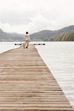 Pregnant Woman Walking on Dock With Her Dog Stock Photo - Rights-Managed, Code: 700-02922753