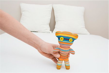 Man Holding a Toy Stock Photo - Rights-Managed, Code: 700-02935681
