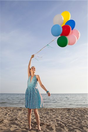 sandi model - Woman on the Beach Holding a Bunch of Colourful Balloons Stock Photo - Rights-Managed, Code: 700-02943254