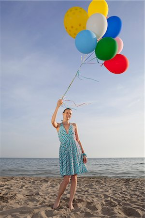 sandi model - Woman on the Beach Holding a Bunch of Colourful Balloons Stock Photo - Rights-Managed, Code: 700-02943255