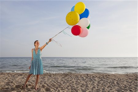 sandi model - Woman on the Beach Holding a Bunch of Colourful Balloons Stock Photo - Rights-Managed, Code: 700-02943256