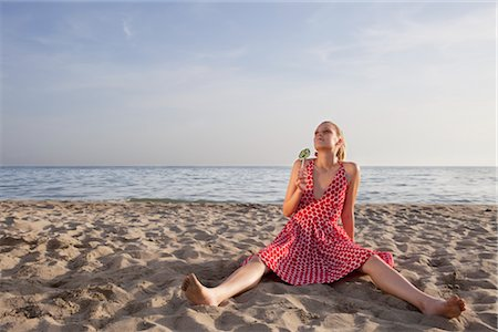 sandi model - Woman With a Lollipop Sitting on the Beach Stock Photo - Rights-Managed, Code: 700-02943261