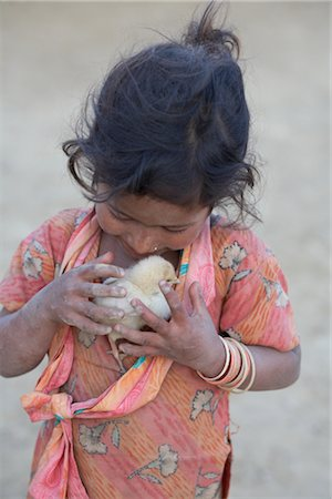 Little Girl Holding Chick, Chapagaon, Nepal Stock Photo - Rights-Managed, Code: 700-02957845