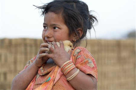 Little Girl Holding Chick, Chapagaon, Nepal Stock Photo - Rights-Managed, Code: 700-02957846