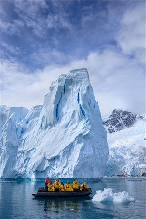 Tourists in Zodiac Boat by Iceberg, Antarctica Stock Photo - Rights-Managed, Code: 700-02967474