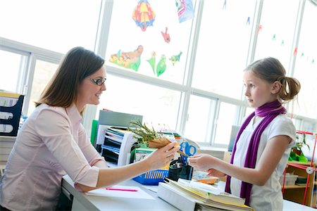 Girl Giving Flowers to Teacher Stock Photo - Rights-Managed, Code: 700-02989929