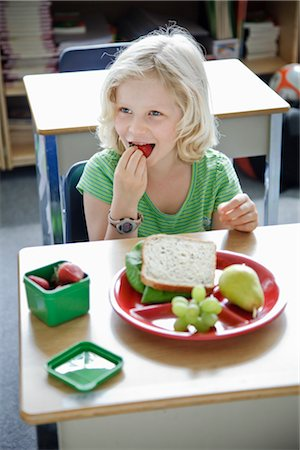 school desk - Student Eating Lunch Stock Photo - Rights-Managed, Code: 700-02989959
