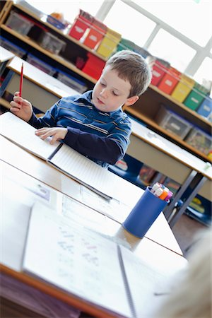 school desk - Boy in Grade One Classroom Stock Photo - Rights-Managed, Code: 700-02989953