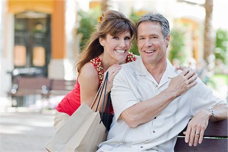 Couple Sitting on Bench, Holding a Shopping Bag Stock Photo - Rights-Managed, Code: 700-03004049
