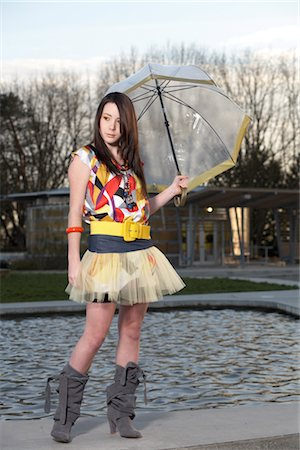 Young Woman Holding Umbrella by Water Fountain Stock Photo - Rights-Managed, Code: 700-03004259