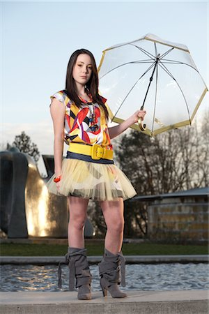 Woman Holding Umbrella near Water Fountain Stock Photo - Rights-Managed, Code: 700-03004260