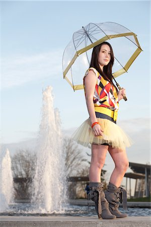 Young Woman Holding Umbrella by Water Fountain Stock Photo - Rights-Managed, Code: 700-03004261