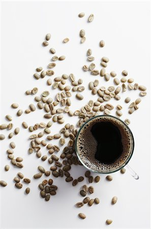 Cup of Coffee Surrounded by Coffee Beans Stock Photo - Rights-Managed, Code: 700-03003894